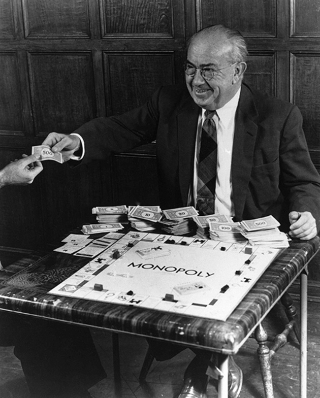 Charles B. Darrow, inventor of the game of Monopoly, is pictured enjoying his game, Jan. 1958. (AP Photo)